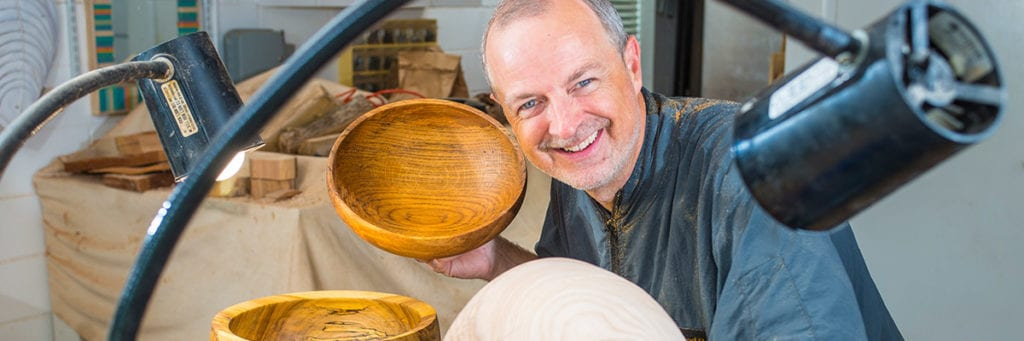 Kent Weakley using a flex arm lamp for woodturning